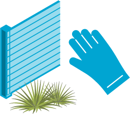 Image of a hand over two plants touching a fence.