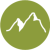 Icon of mountains with a light green circle background.